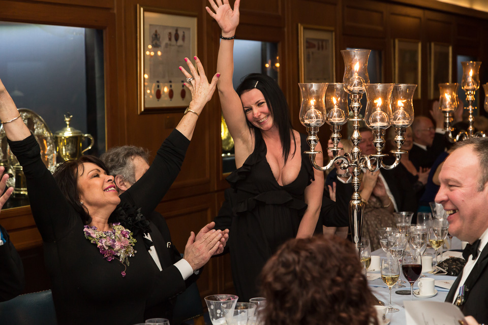 Diners holding up hands at the table