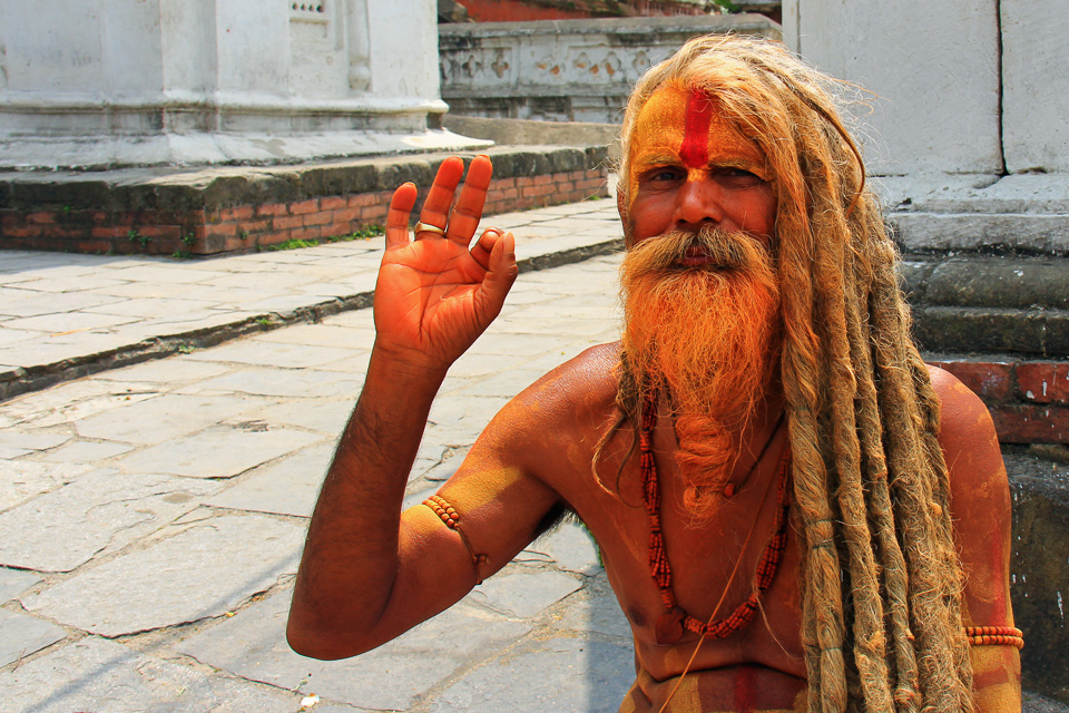 Orange man at Hindu Temple Kathmandu Nepa