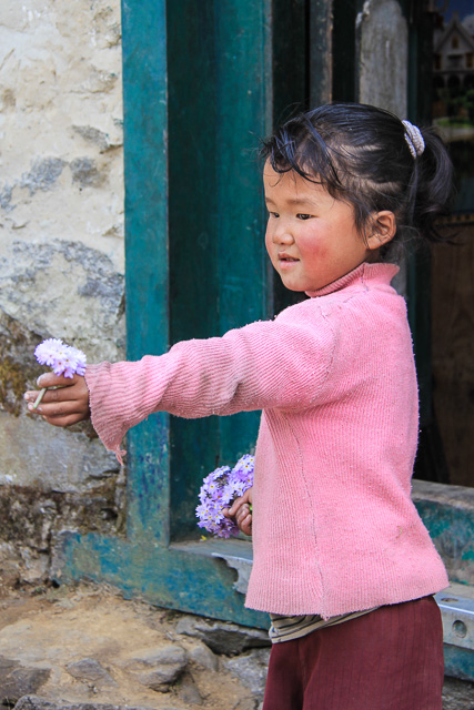 little girl with gifts for trekkers