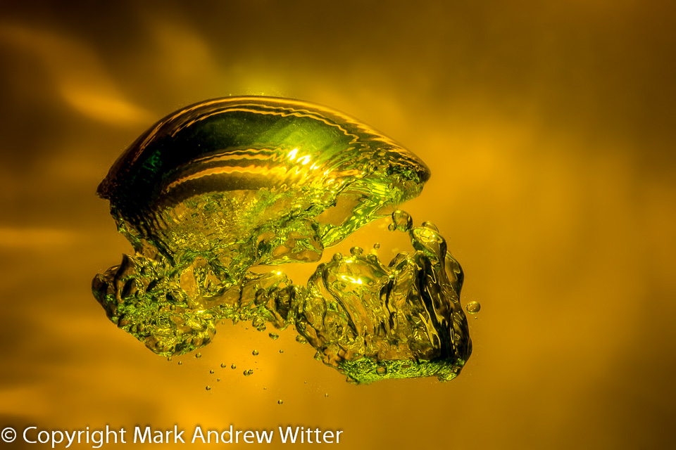 Gold skull like air bubble under water