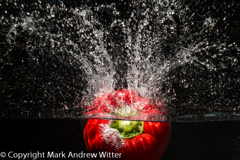 red pepper splashing into water