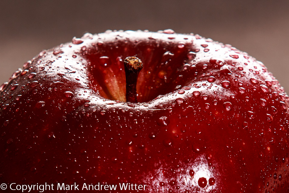 close up of red apple and water drops