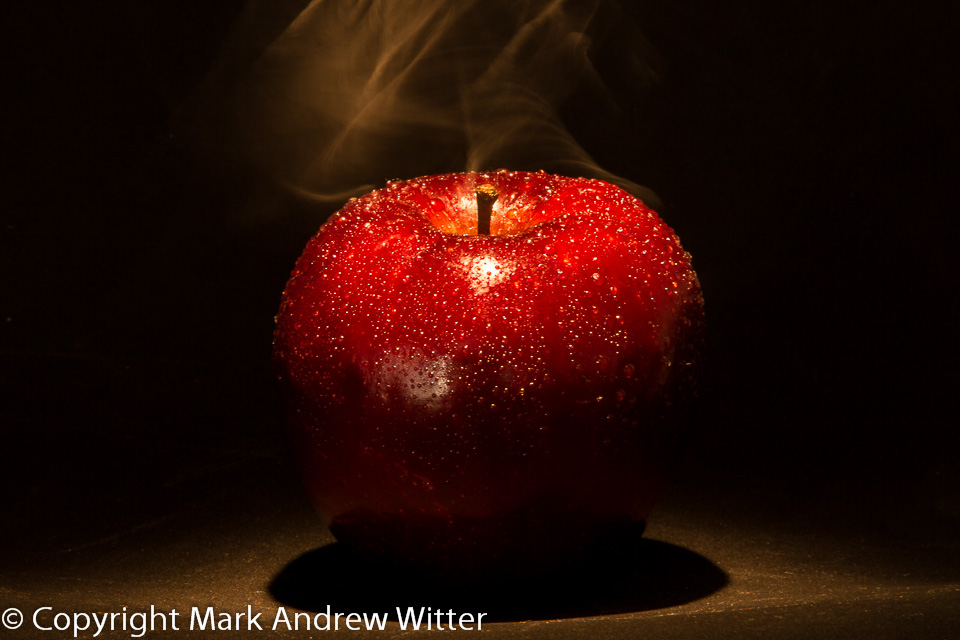 Red apple with smoke