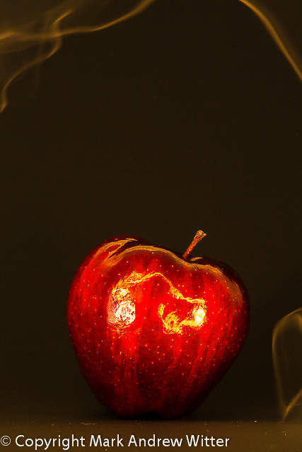 Apple with smoke trails