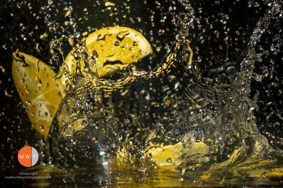 Image of a lemon splashing in water