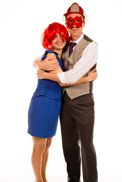Mobile Photo studio- couple hugging in hats and wig