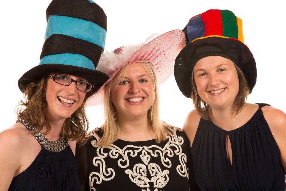 Three friends in fancy dress hats - Mobile Photo Studio
