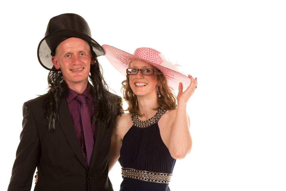 Man and lady in fancy dresss hats Mobile Photo Studi