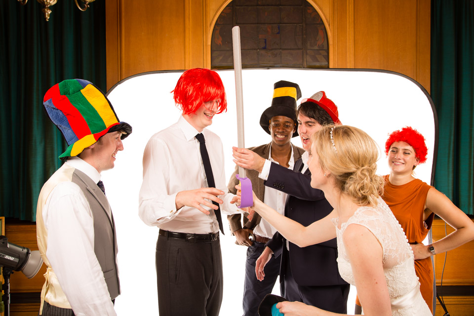 party guests with fancy dress sword