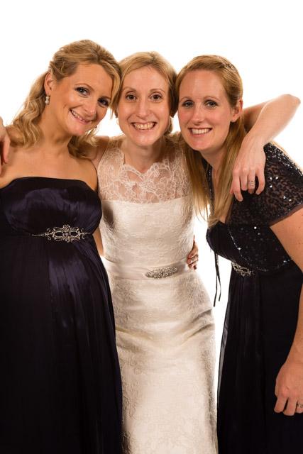 Mobile Photo Studio bride and bridesmaids hugging