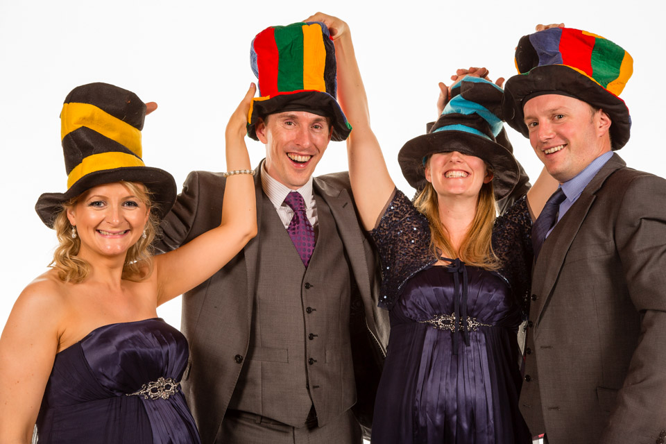 Party guests in fancy dress hats