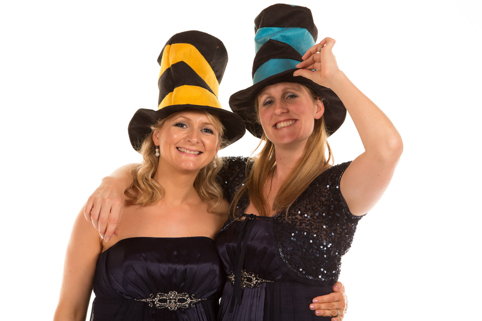 two party goers in hats