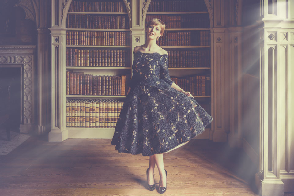 model in party dress in library