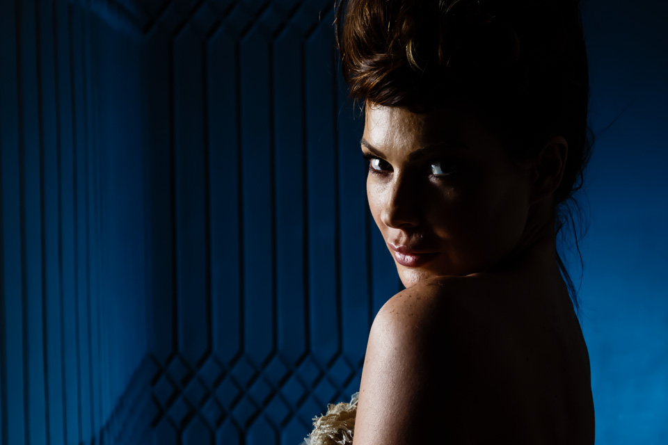 haed shot of model with blue background