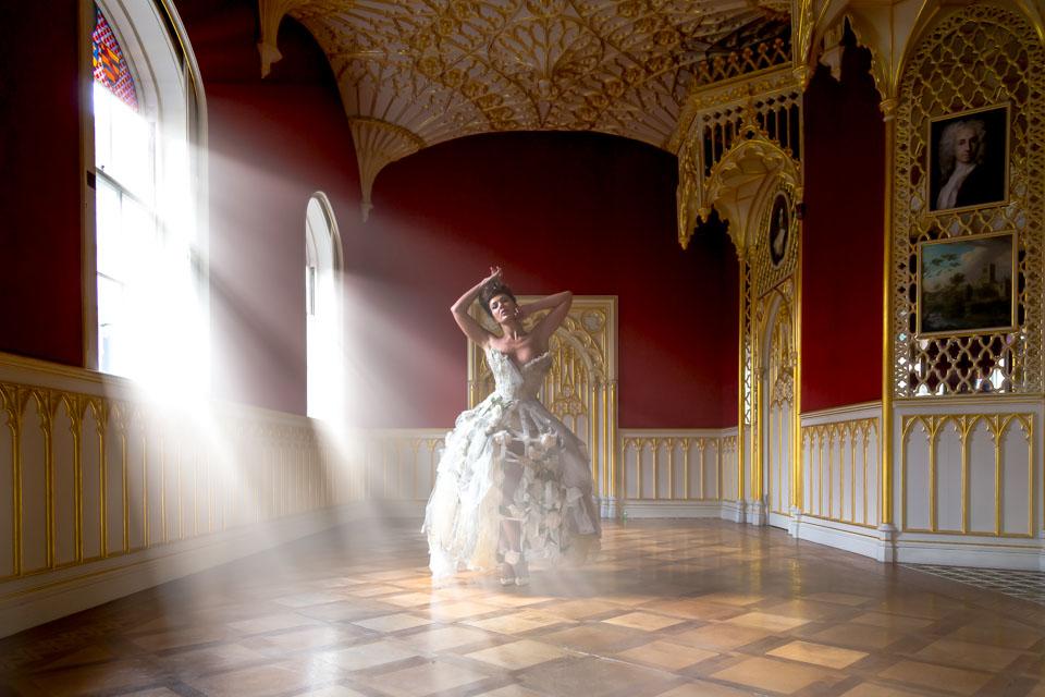 sunlight streaming on model in birdcage dress