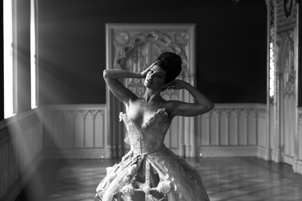 model in birdcage dress