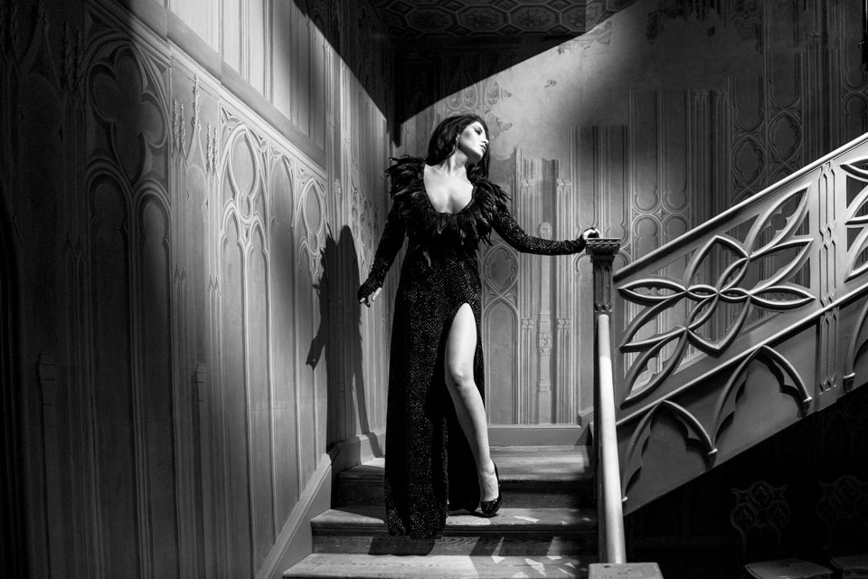 model on stairs in feather dress in black and white