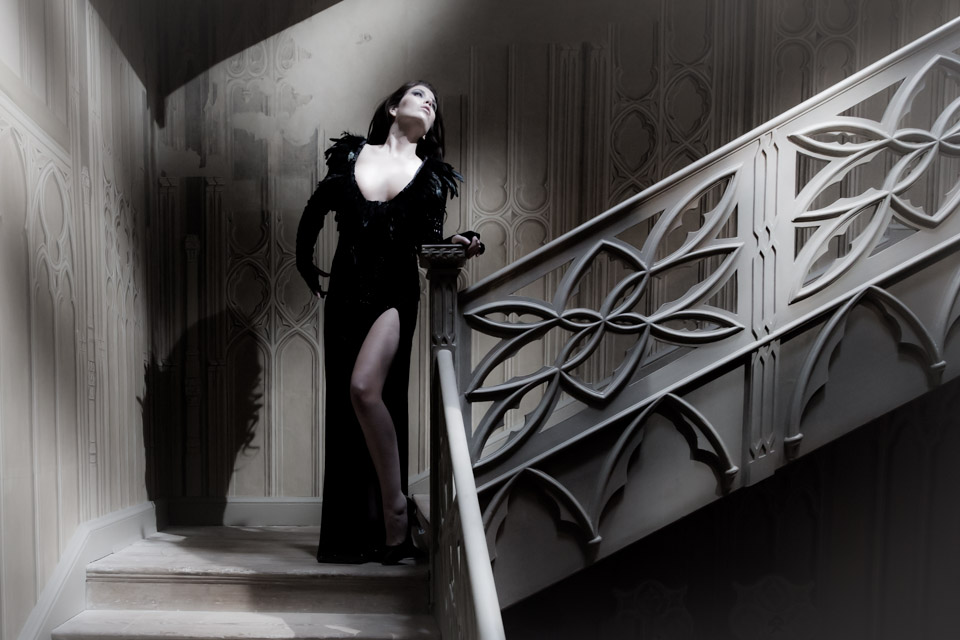model on stairs in old house