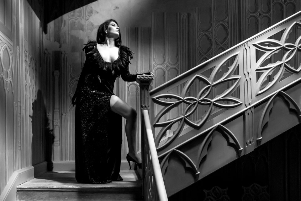 black and white model on stairs