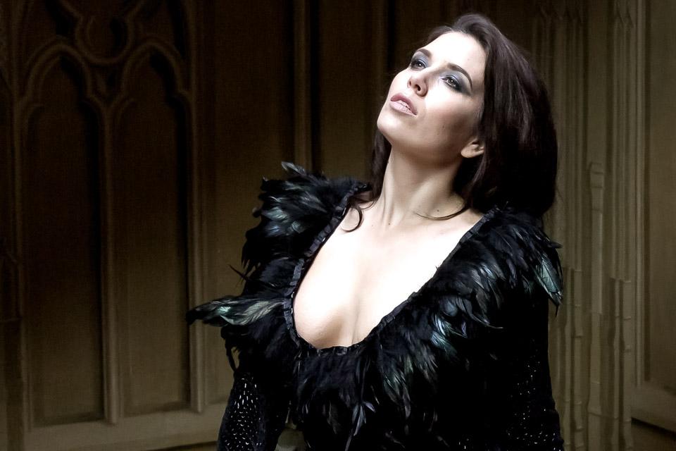 Model in black feather dress