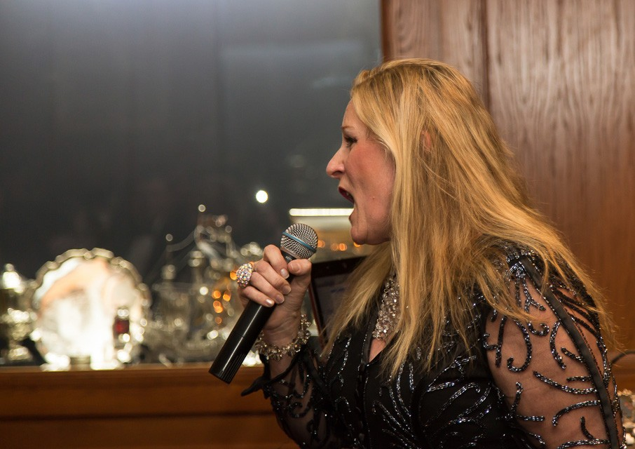 singer with microphone at event