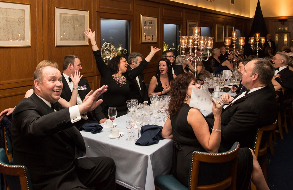 Diners waving at dinner table