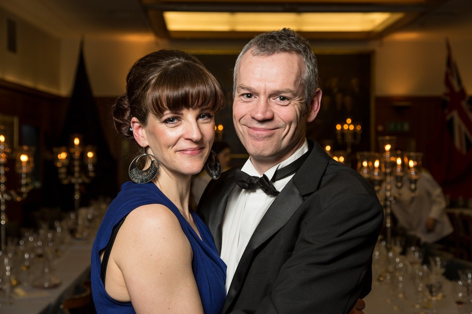 man and woman in embrace at Beadles' Guild Dinner