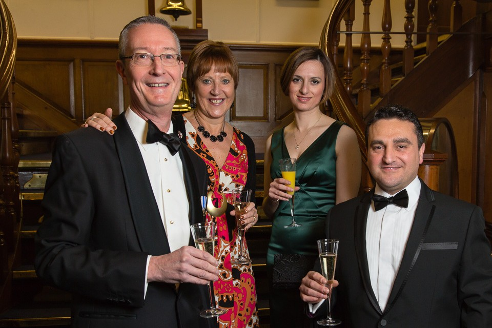 Beadles' Guild Dinner guests on stairs