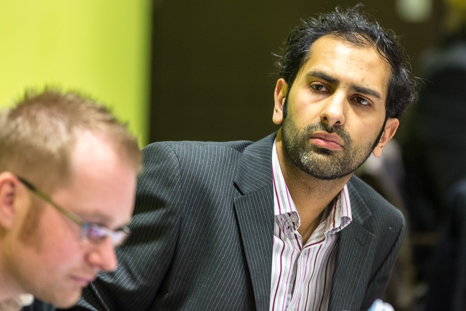 close up of conference delegate looking around