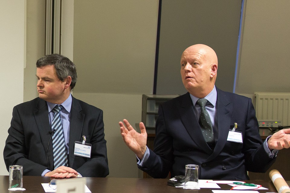 speakers debating at conference
